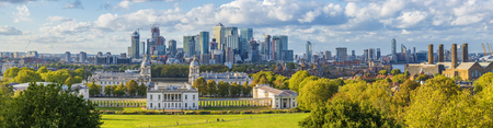 London, England, Panoramic Skyline View Of Greenwich College and Canary Wharf At Golden Hour Sunset With Blue Sky And Clouds Editorial