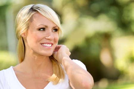 Blonde happy woman outside