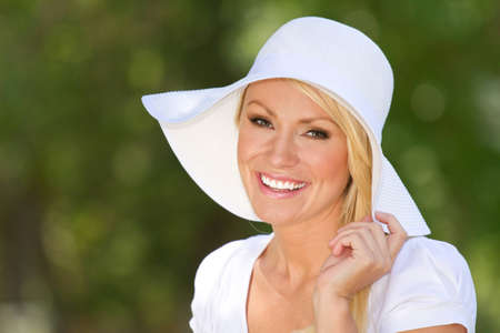30 s: A young blonde smiling woman outside