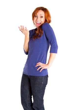 A red headed woman smiling and gesturing. Zdjęcie Seryjne