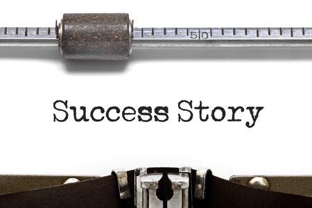 conquering adversity: Success Story written on an old typewriter