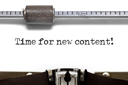 keywords link: Time for new Content printed on an old typewriter Stock Photo