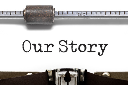 narrate: Our Story text on Typewriter Stock Photo