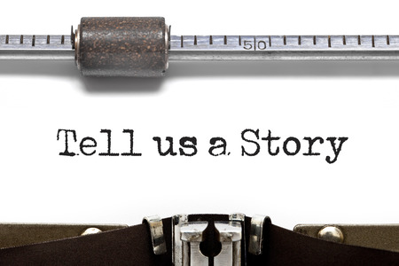 narrate: Tell us a Story on Typewriter Stock Photo