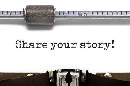narrate: Close up vintage typewriter with paper sheet, typing Share Your Story