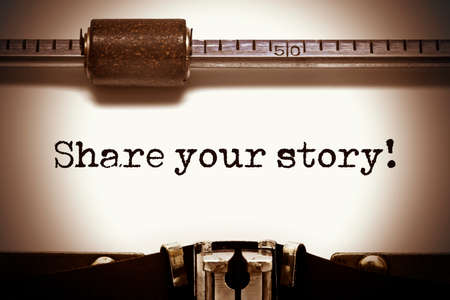narrate: Close up vintage typewriter with paper sheet typing Share Your Story