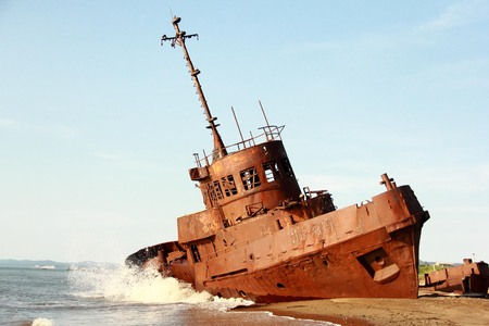 uncouth: Old abandoned ship on the sea, beat waves