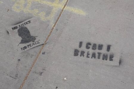 I can't breathe stenciled in spray paint on a sidewalk.