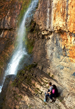 young couple watch bulgarian nature beautiful waterfall