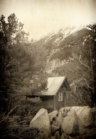 Vintage Bulgarian wooden cottage in high Pirin mountain photo