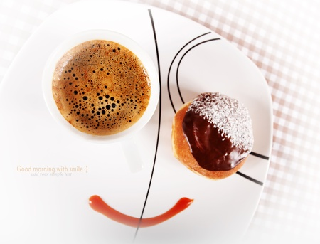 food concept smile image with strong black coffe and donut. Space for sample text