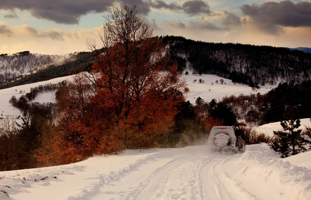 high mountain road in winter. Off-road adventure travel in Bulgaria photo