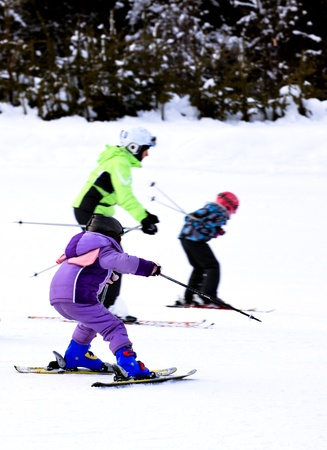 active child drive ski in winter holiday
