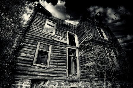 damaged houses: abadoned spooky house in black and white
