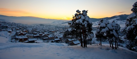 panoramic winter landscape over the small village photo