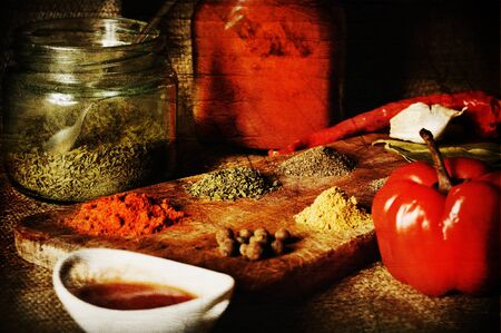 vintage spice composition in wood textured background photo