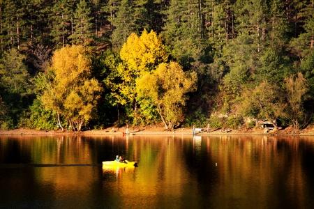 autumn leke with boat in bulgaria