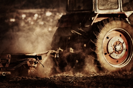 farm machinery: vintage agriculture industrial background in autumn time