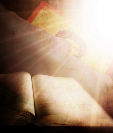 sanctification: abstract holly light over the human hand and bible Stock Photo