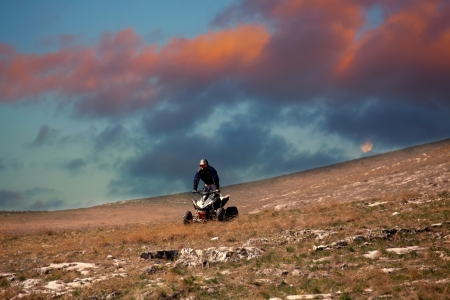 riding atv in sunset time