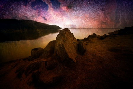 abstract cosmos landscape with lake and rocks Stock Photo