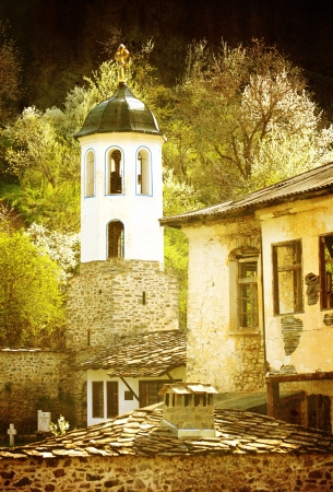 vintage monastery with church in bulgarian village  photo