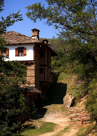 ethnographic: authentic old bulgarian houses in Kovachevica village- vertical old village landscape