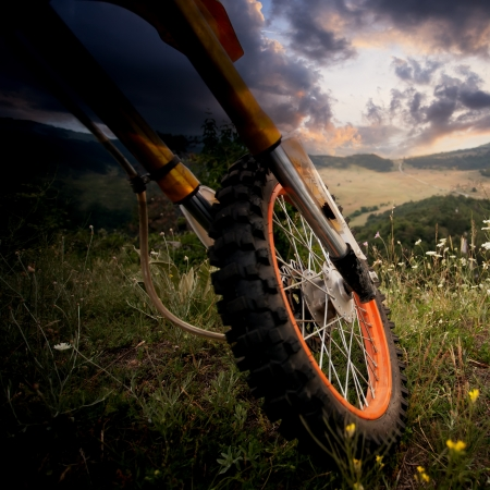 dirt bike close-up details over the scenic HDR sunset photo