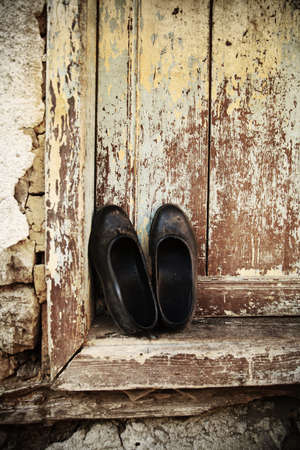 old shoes on vintage background  photo