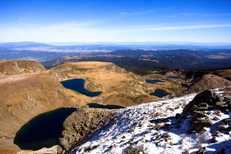 all seven Rila lakes in bulgarian mountain- sunny winter background