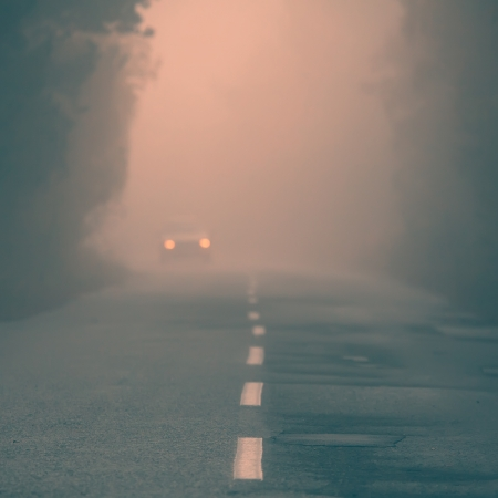abstract fogy forest road and car- ink saturated conceptual  Stock Photo
