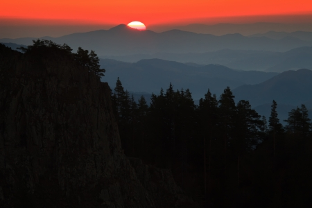 rise above: sun rise above the rocky mountains  Stock Photo