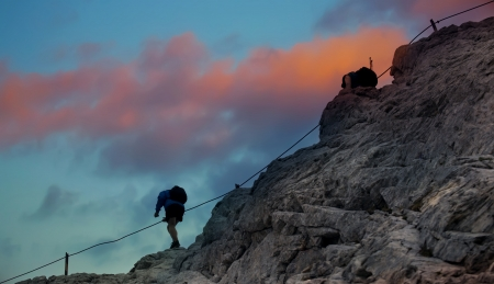 high mountain climber in stunning HDR red sunset  photo
