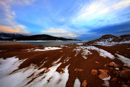 blue stunning sunset over the winter high mountain lake in bulgaria  photo