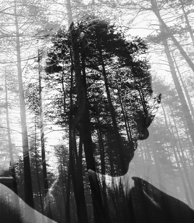 aabstract black and white double exposure woman silhouette in deeep forest