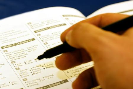 man hand writing exam in college