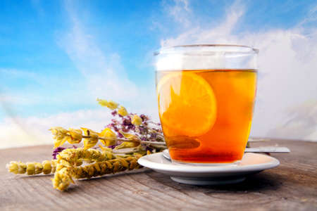 healthy herbal tea against blue sky, food and drink conceptual background  photo