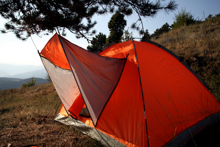 high mountain camping tent in sunset time  photo