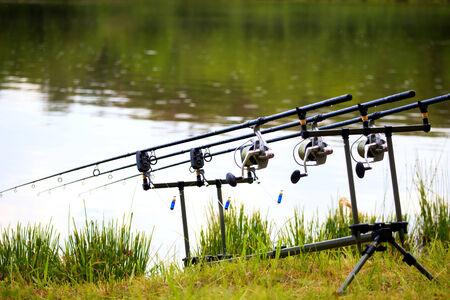 fishing rod near rainy lake in spring