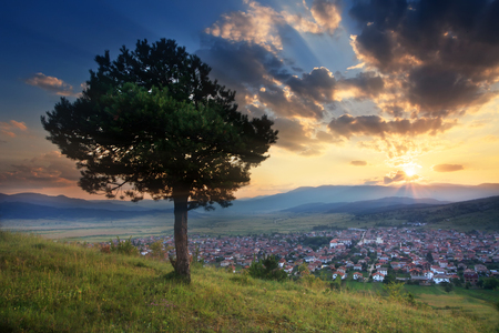 stunning HDR sunset over the small valley with village in bulgarian Rhodope mountain  photo