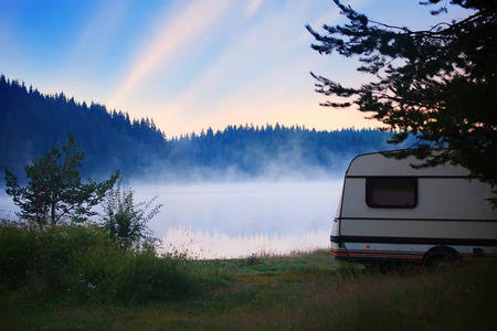 RV camper near lake, sunrise in bulgarian nature