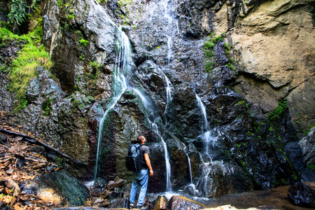 man watch beautiful waterfall in bulgarian mountains  photo