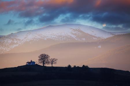karavanke: Colorful winter HDR down over the small mountain church in bulgaria