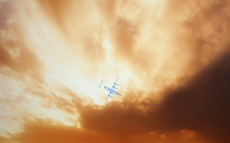 undercarriage: airplane flying close to the storm in sunset time