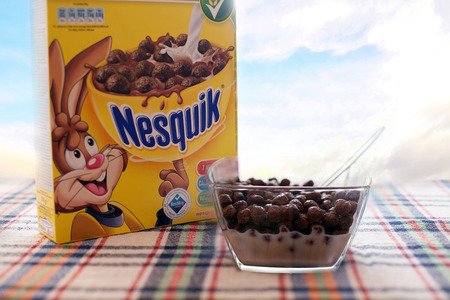 nestle: SOFIA, BULGARIA -MAY 14,2015: Nestle Nesquik Cereal over the soft morning blue sky background.Nestle is a Swiss multinational food and beverage company. It is the largest food company in the world measured by revenues.