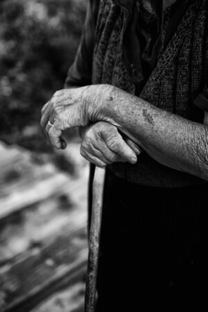 recollection: old woman hand close-up in black and white Stock Photo