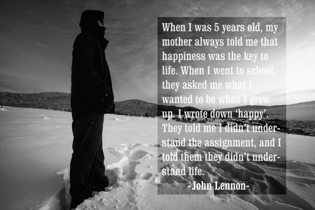 john lennon: Quote of the famous american singer John Lennon over the black and white landscape with man stand in winter land