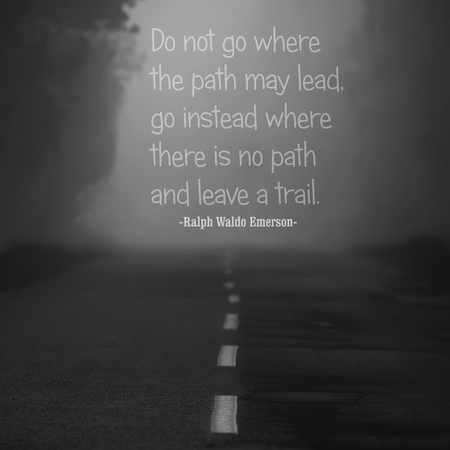 famous writer: Quote of the famous american writer Ralph Waldo Emerson at the black and white landscape with misty road Stock Photo