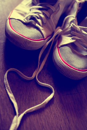 swain: ink filtered teen love background with sneaker shoes Stock Photo