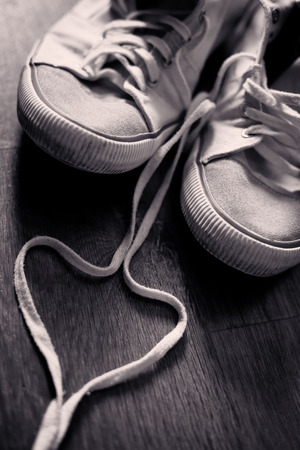 swain: teen daily sneaker shoes conceptual love background, duotone vintage colored background